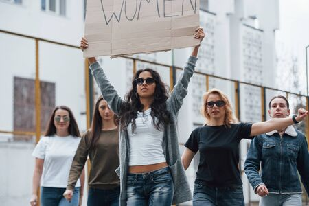 Caucasian ethnicity. Group of feminist women have protest for their rights outdoors.