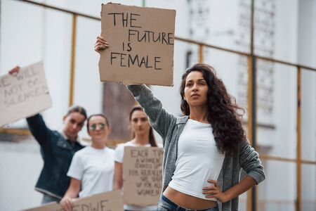 Strong woman. Group of feminist girls have protest for their rights outdoors.