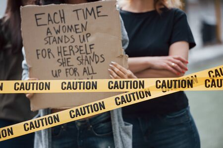 Close up view. Group of feminist women have protest for their rights outdoors.