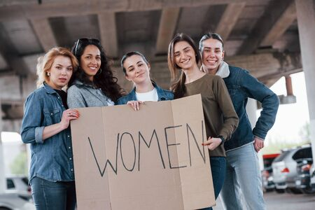 Having good mood. Group of feminist women have protest for their rights outdoors.