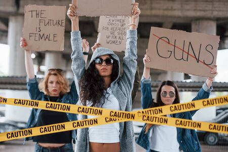 Attention needed. Group of feminist women have protest for their rights outdoors.