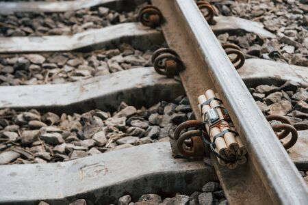 Rusty metal. Timebomb on the railway at daytime outdoors. Conception of terrorism and danger. Stock fotó