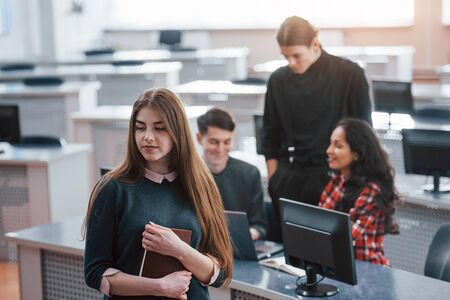 New day has come. Group of young people in casual clothes working in the modern office. Zdjęcie Seryjne