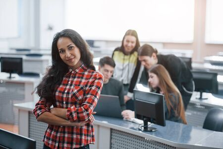 Easy and fun. Group of young people in casual clothes working in the modern office.