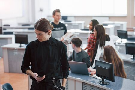 Thoughtful look. Group of young people in casual clothes working in the modern office.
