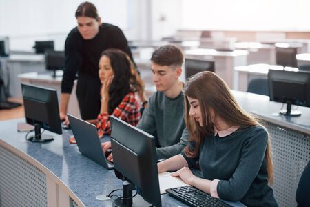 Spacious area. Group of young people in casual clothes working in the modern office.