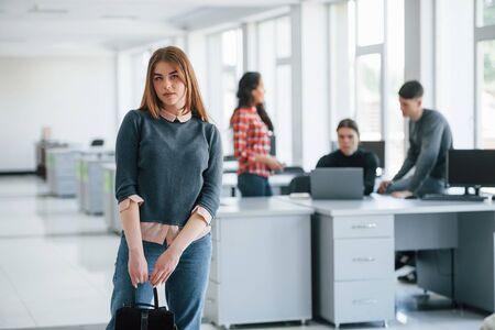 New tasks is waiting today. Group of young people in casual clothes working in the modern office.