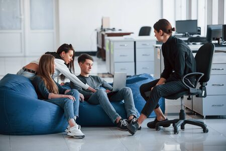 This might be interesting information. Group of young people in casual clothes working in the modern office.
