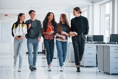 Work will not wait. Group of young people walking in the office at their break time.