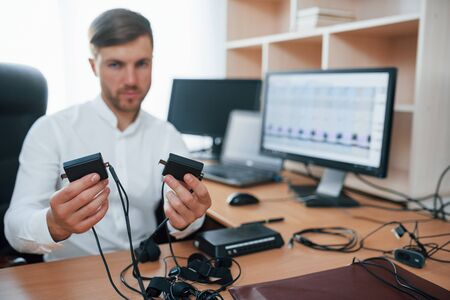 This will test your heart rate. Polygraph examiner works in the office with his lie detectors equipment.