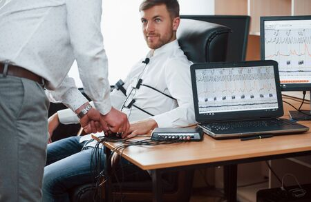 Here we begin our session. Preparation for the polygraph test. Conception of the lie detector. Фото со стока