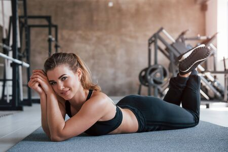 Thats a nice feeling. Photo of gorgeous blonde woman in the gym at her weekend time. Stock Photo