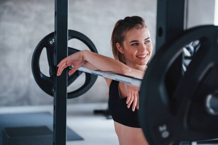 Full of energy. Photo of gorgeous blonde woman in the gym at her weekend time.