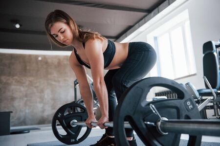 Warm temperature. Photo of gorgeous blonde woman in the gym at her weekend time. Stock Photo