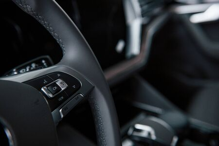 Buttons for turn lights and more. Close up view of interior of brand new modern luxury automobile. 写真素材