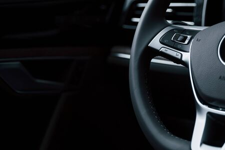 Smooth material. Close up view of interior of brand new modern luxury automobile. Imagens