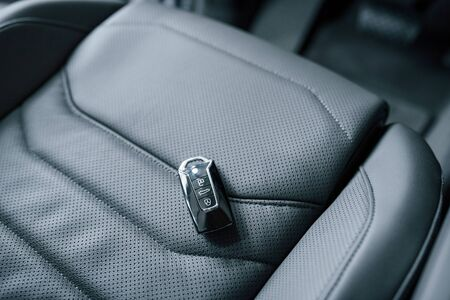 Its almost your. Close up view of interior of brand new modern luxury automobile. Banco de Imagens