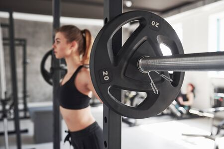 Fitness day. Photo of gorgeous blonde woman in the gym at her weekend time. Stock fotó