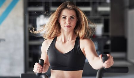 Nice long hair. Photo of gorgeous blonde woman in the gym at her weekend time. Stock fotó - 135497283