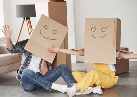 Conception of happy couple. People together in their new house. Conception of moving. Imagens