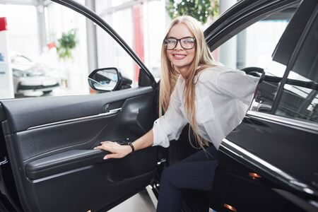 So how it feels. Girl have tested her new black car. Looks like shes satisfied.