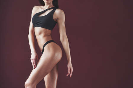 Clean skin. Pretty young woman with nice fitness body shape posing in the room.