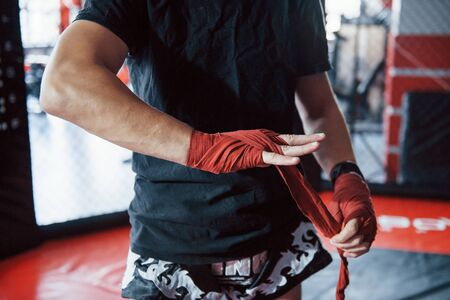 Preparation before the training. Close up shot of young boxer. Stock Photo