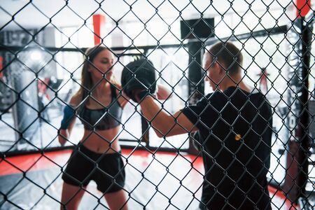 Athletic young people have sparring on the boxing ring. Stock Photo