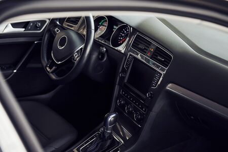 Inside of brand new modern electrical car. Particle view. Cropped photo. Stok Fotoğraf