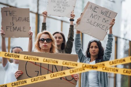 Displeased people. Group of feminist women have protest for their rights outdoors. Imagens
