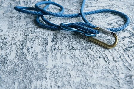 Its lifesavior. Knot with metal carabiner. Silver colored device for the active sports.