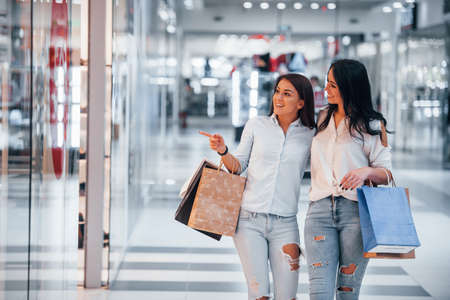 Two young women have a shopping day together in the supermarket. Standard-Bild