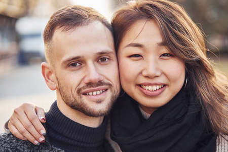 Portrait of multiracial couple. Asian girl with her caucasian boyfriend.
