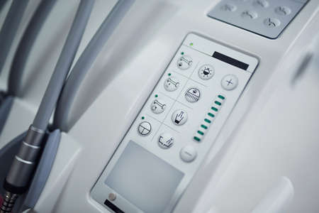 Close up view of medical chairs control panel with buttons.