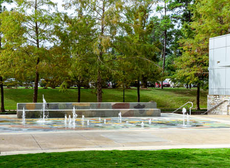 A splash pad for children to play on at a public park in The Woodlands, TX.