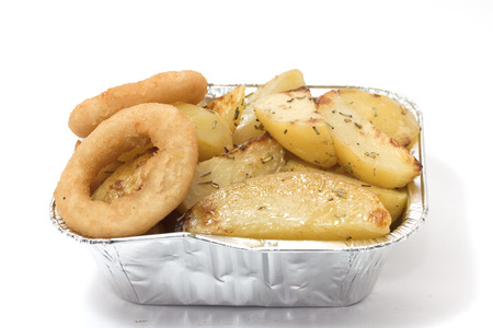 potatoes and onions cooked in the oven with aluminum tray