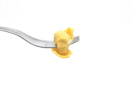 stuffed tortellini: Traditional pasta stuffed tortellini with fork