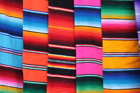 Mexico Mexican poncho serape poncho rug background fiesta cinco de mayo with stripes fabric textile material