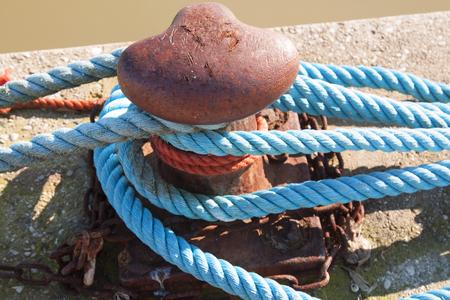 Bollard and mooring rope for mooring yachts and boats