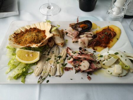 course and plate of hot seafood appetizer Stok Fotoğraf