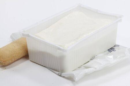 soft cheese of bovine stracchino with tray