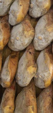 pork leg hams hung for vertical seasoning