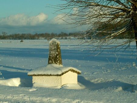mile: Mile stone in snow Stock Photo