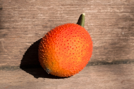 Fruit of the Asian region. The spiny nature is fresh. The ball is green. The harvest will be orange red. Bring a picture of fruit juice is sweet to the polite Stock Photo