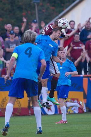 ceske: Zivanice 7.9.2014 _ Jiri Podebradsky, Roman Bednar in air duel. 3.Round of Czech soccer Cup (Pohar Ceske posty) between team from Division C (Czech 4th league) and last czech champions.