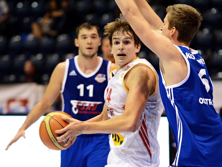 Ondrej Kohout from Pardubice. Defended by Jan Koloni?n?. 1st round of Kooperativa national basketball league between BK JIP Pardubice and NH Ostrava ends with score 84:71.