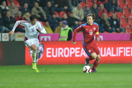 Prague 03.28.2015 _ Igors Tarasovs and Tomas Rosicky. Match of the EURO 2016 qualification group A Czech Republic - Latvia 1: 1 (0: 1). Goals 90 Pilar - 30 Vinakovs.