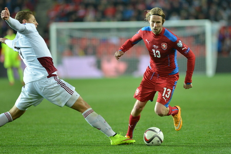 Prague 03.28.2015 _ Kaspars Dubra and Jaroslav Plasil. Match of the EURO 2016 qualification group A Czech Republic - Latvia 1: 1 (0: 1).