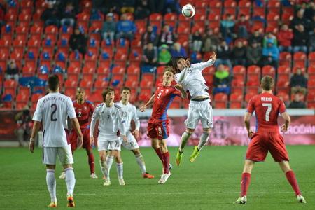 Prague March 28, 2015 _ boek dokal and Igors Tarasovs in heading. Match of the EURO 2016 qualification group A Czech Republic - Latvia 1: 1 (0: 1). Goals 90 Pilar - 30 Vinakovs. Redakční