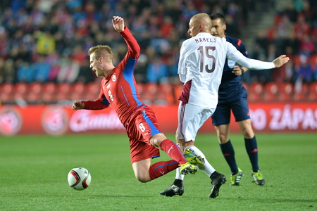 Prague March 28, 2015 _ Deniss Rakels foul on David Limbersk. Match of the EURO 2016 qualification group A Czech Republic - Latvia 1: 1 (0: 1). Goals 90 Pilar - 30 Vinakovs. Redakční